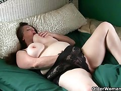 Large-Breasted granny takes care of the brush throbbing clit