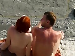 Sexy Red Haired Woman Blowjob On Nudist Beach
